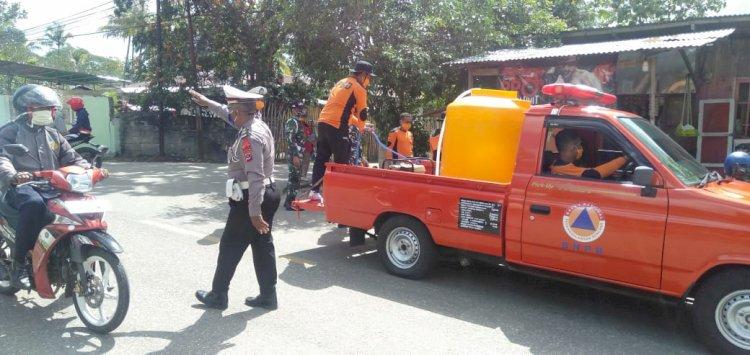 Sinegritas TNI - Polri Gandeng BPBD Lakukan Penyemprotan Disinfektan